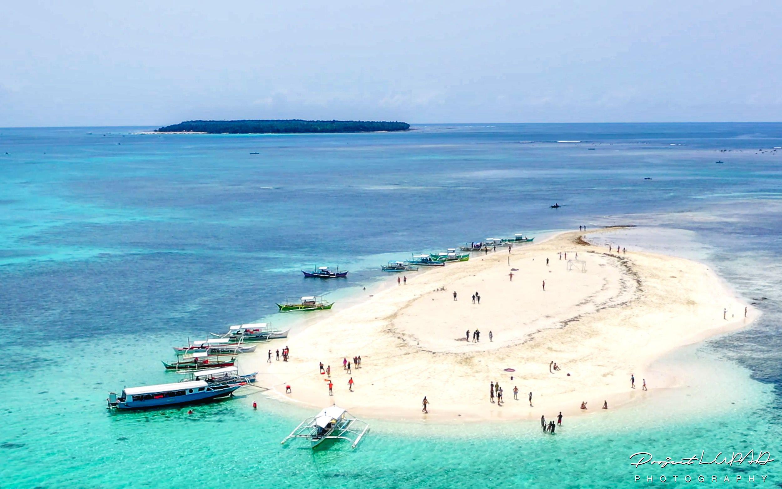 PHILIPPINES: SIARGAO: ISLAND HOPPING: GUYAM ISLAND, NAKED